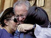 Javier Sicilia hugs two women