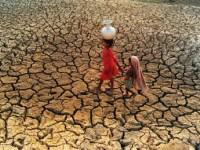 Two women going for water in a drought.