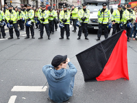 Anarchist protestors against the police