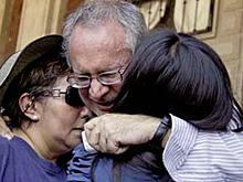 Javier Sicilia hugs two women