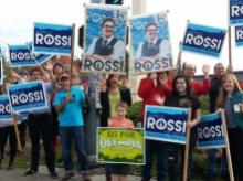 People waving signs for Marco Rossi to be elected mayor of Olympia, Washington