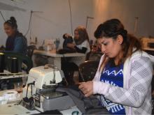 Women working at the Amarge textile Cooperative, Kobane