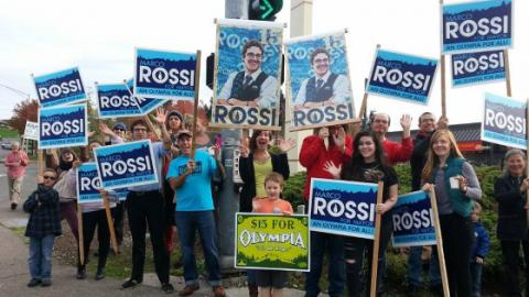 Supporters of Marco Rossi waving signs.